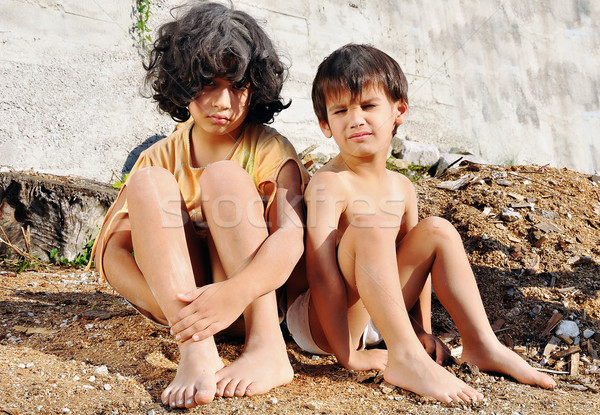 Poverty and poorness on the expression of children Stock photo © zurijeta