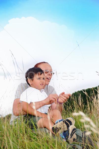 Happy kid in nature with his grandmother Stock photo © zurijeta