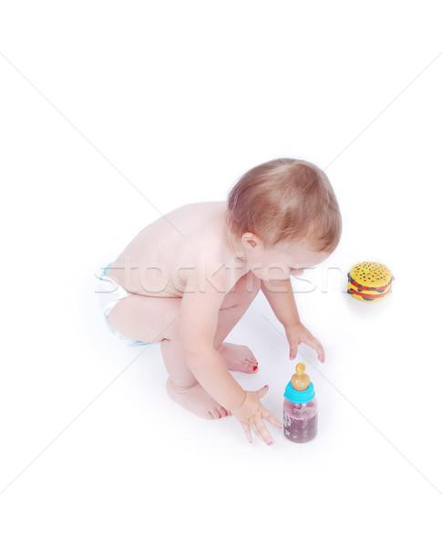 Baby between hamburger and drinking bottle Stock photo © zurijeta