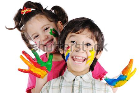 Thre beautiful painted kids standing in a row one after another Stock photo © zurijeta