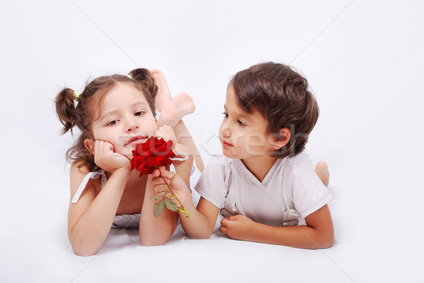 Stock photo: Beautiful scene of a girl and boy laying on ground
