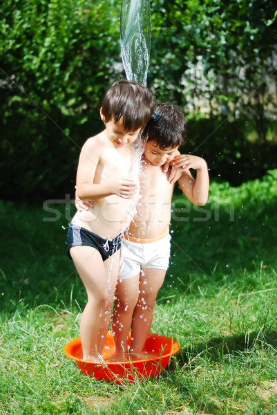 Two kids summer playing with water outdoor Stock photo © zurijeta