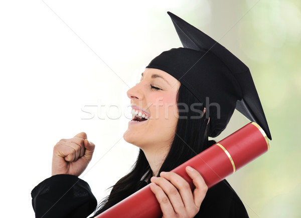 Graduating glory and pride, happy female with diploma in hands Stock photo © zurijeta