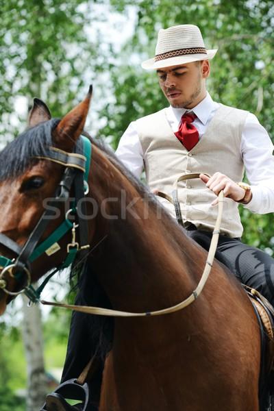 Młodych elegancki człowiek jazda konna konia Zdjęcia stock © zurijeta
