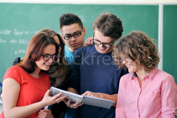 Young man showing a copybook Stock photo © zurijeta
