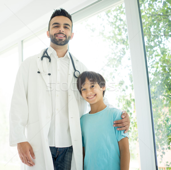 Doctor examining a boy at hospital Stock photo © zurijeta