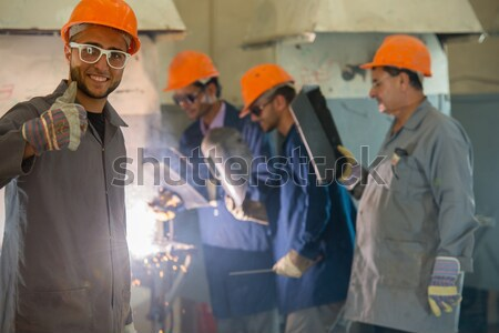 Worker with protective mask welding metal in factory Stock photo © zurijeta