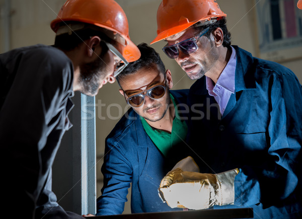 Workers in industrial factory welding Stock photo © zurijeta