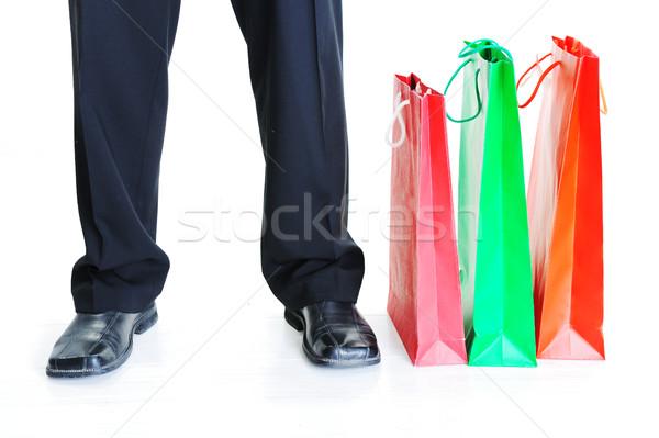 Closeup of a men`s legs standing beside shopping bags Stock photo © zurijeta