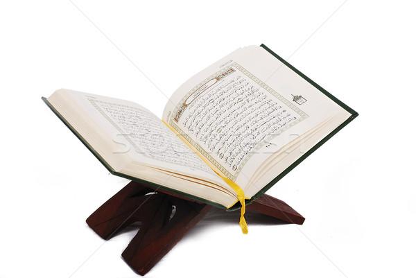 Holy islamic book Koran opened and isolated Stock photo © zurijeta