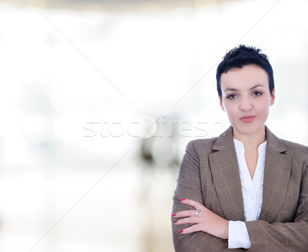 Closeup portrait of cute young business woman smiling in modern bright building Stock photo © zurijeta