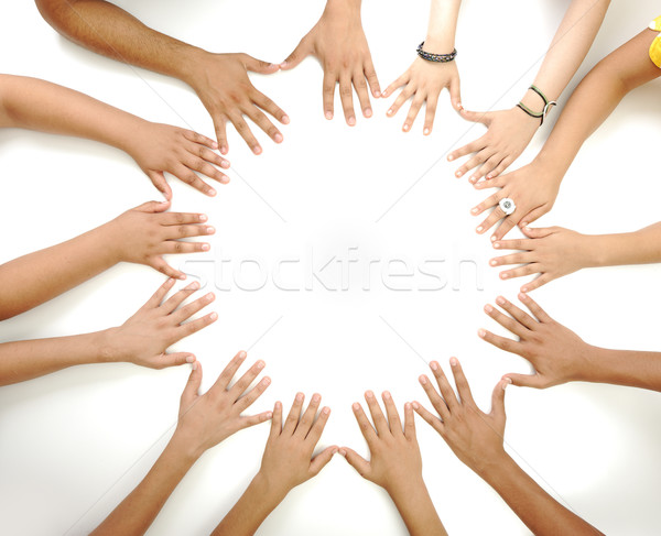 Stock photo: Conceptual symbol of multiracial children  hands making a circle on white background with a copy spa