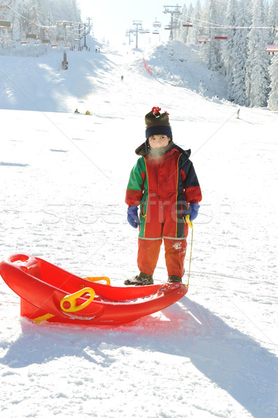 Kid on snow with sledge, frozen breath out of his mouth :) Stock photo © zurijeta