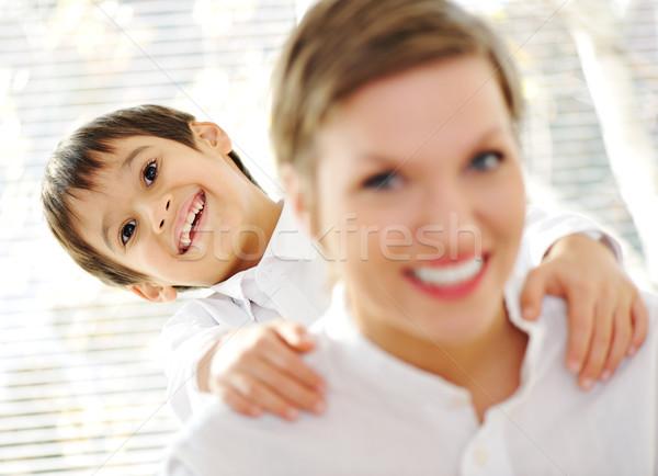 Portrait of young mother piggybacking her son indoor Stock photo © zurijeta
