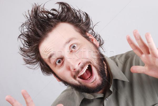 Crazy młodych biznesmen wyraz twarzy działalności twarz Zdjęcia stock © zurijeta