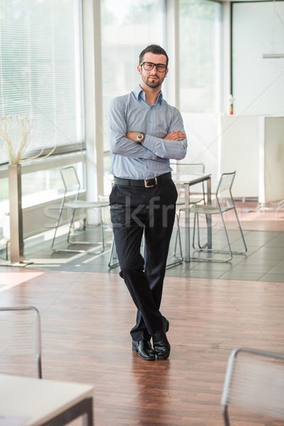 Business man posing in an office Stock photo © zurijeta