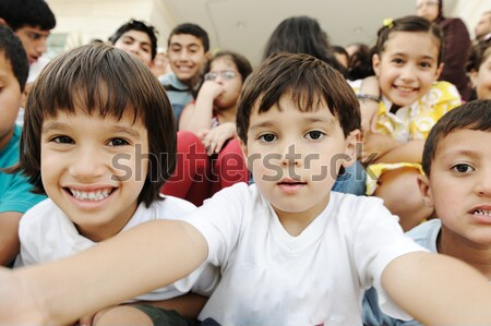 Crowd of children, different ages and races in front of the scho Stock photo © zurijeta