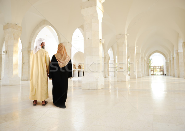 Muslim arabic couple inside big oriental empty modern building Stock photo © zurijeta