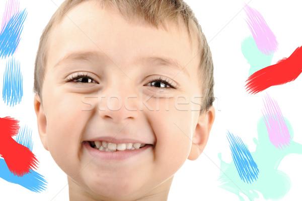 Happy boy smiling, colors around, isolated Stock photo © zurijeta