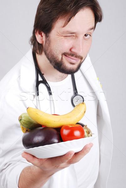 Doctor with healthy food Stock photo © zurijeta