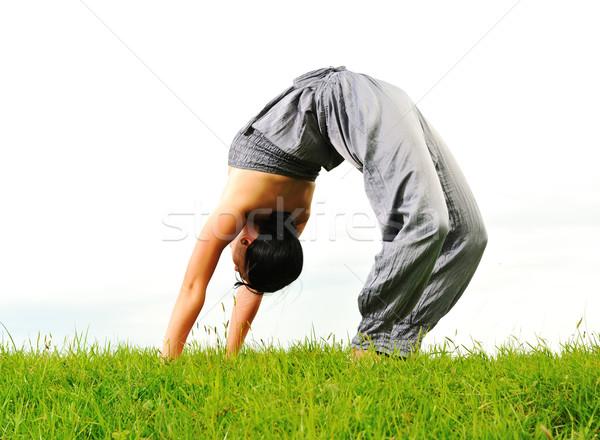 Acrobatique Homme extérieur fille soleil étudiant Photo stock © zurijeta