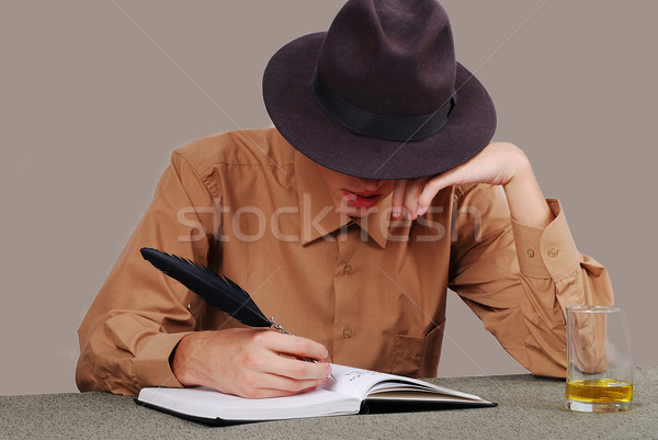 A poet writting on desk with the glass beside Stock photo © zurijeta