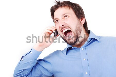 Angry man and phone Stock photo © zurijeta