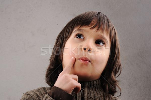 Schooljongen knap kid jaren oude gezichtsuitdrukkingen Stockfoto © zurijeta