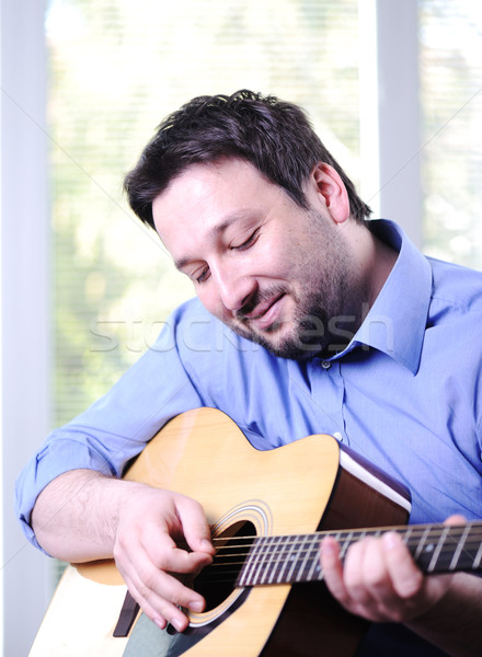 Man playing guitar indoor Stock photo © zurijeta