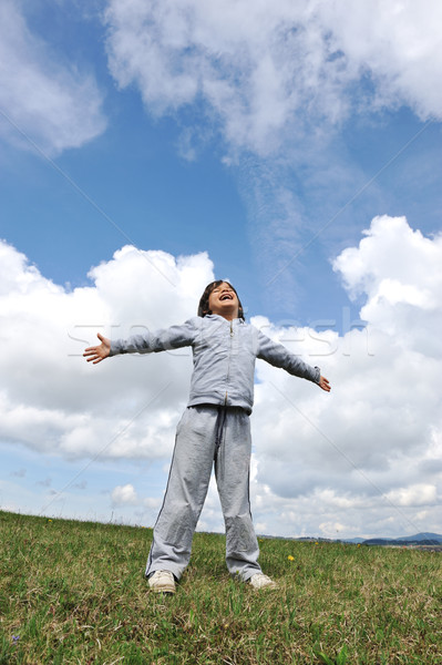 Little boy feeling a freedom on meadow in nature Stock photo © zurijeta
