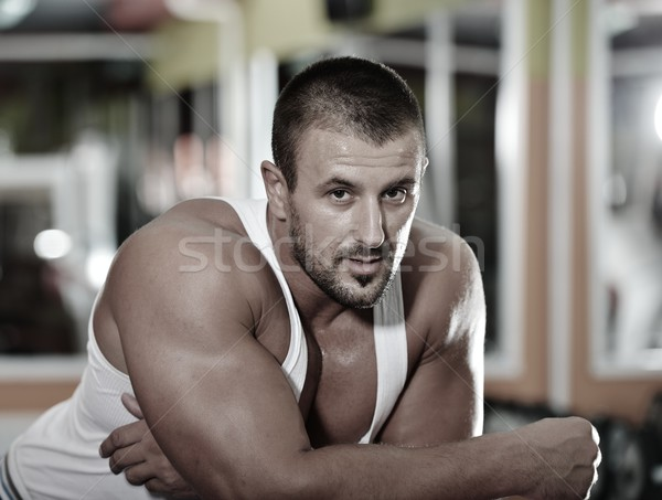 Athletic bodybuilder, execute exercise in sport gym hall Stock photo © zurijeta