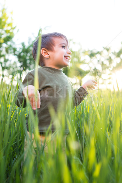 Baby in grass Stock photo © zurijeta