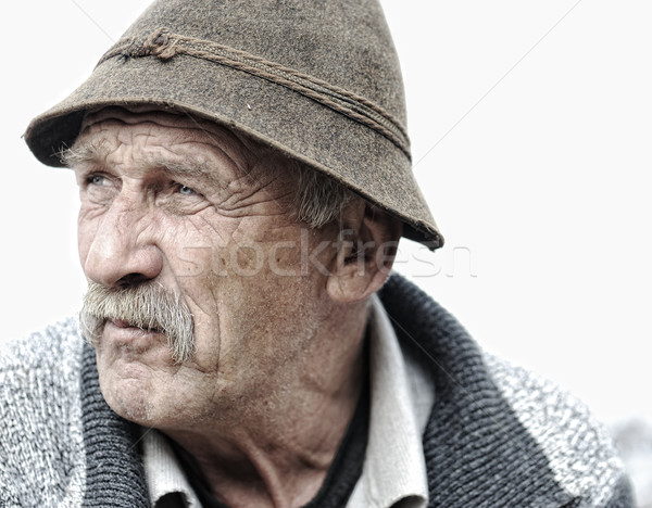 Elderly man's face over white background Stock photo © zurijeta