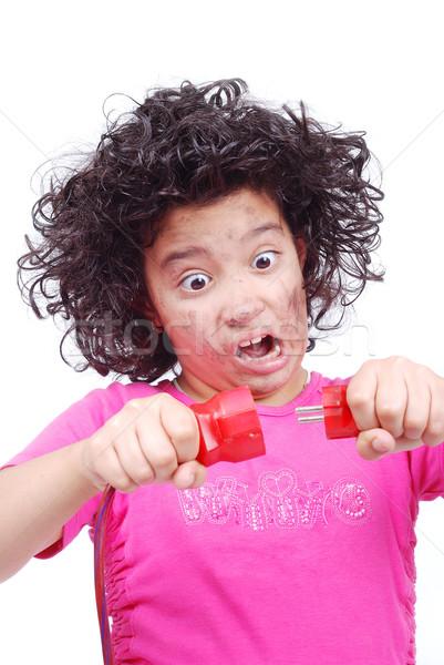 Bonitinho menina elétrico arame mãos Foto stock © zurijeta
