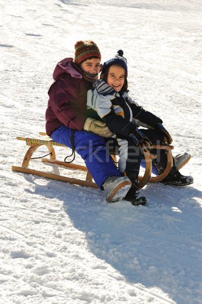 Happy children on snow Stock photo © zurijeta