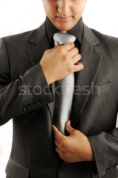 Businessman adjusting his tie Stock photo © zurijeta