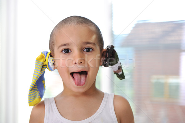 Funny boy with socks on ears :) Stock photo © zurijeta