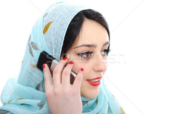Arabic girl talking on cell phone Stock photo © zurijeta