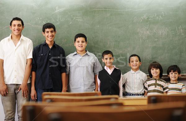 Children at school from smaller to bigger line row Stock photo © zurijeta