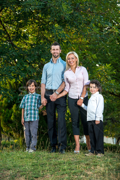 Smiling family posing Stock photo © zurijeta