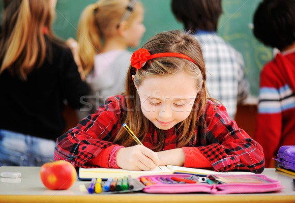 Cute lovely school children at classroom having education activi Stock photo © zurijeta