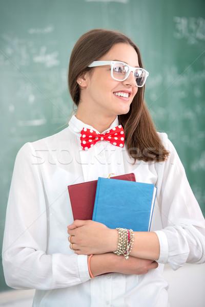 Smart schoolgirl with bowtie Stock photo © zurijeta