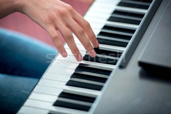 Hand playing a piano Stock photo © zurijeta