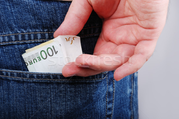 Currency, one hundred euro in hands of male Stock photo © zurijeta