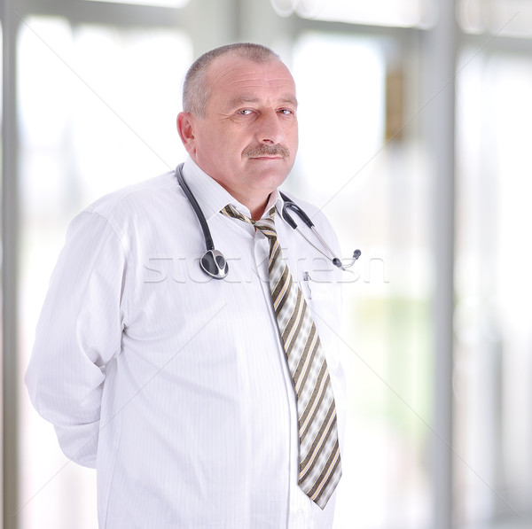 gray hair expertise handsome senior doctor hospital portrait white corridor Stock photo © zurijeta