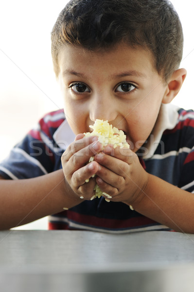 Ritratto povertà piccolo poveri ragazzo alimentare Foto d'archivio © zurijeta