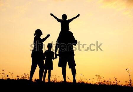 Silhouet gelukkig kinderen moeder vader familie Stockfoto © zurijeta