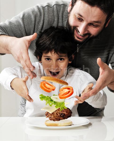 Kid and father making burger together Stock photo © zurijeta