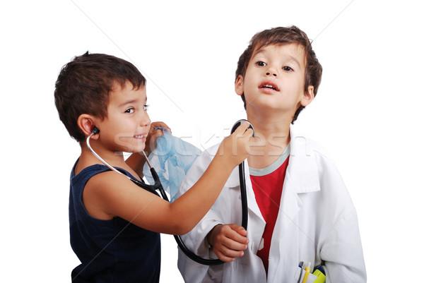 Two kids with health examination by stethoscope Stock photo © zurijeta