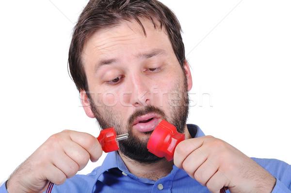 Jonge man verwonderd gezicht elektriciteit glimlach man Stockfoto © zurijeta